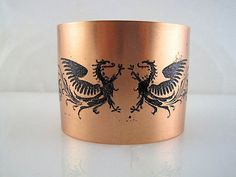 Copper Cuff Double Dragons Design and Vine Design with Black Patina. Very awesome cuffs! shop-finds