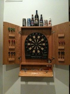 This is the dart board cabinet I built for my electronic dart board. Electronic Dart Board Cabinet, Wood Projects, Woodworking Projects, Over The Toilet Cabinet, Cabinet Plans, Man Room, Wood Plans, Diy Cabinets, Cool Rooms