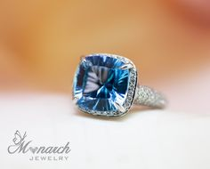 Cushion Quantum cut (Specialty cut) Blue Topaz ring with a diamond micro pave setting from Monarch Jewelry in Winter Park, Florida. #BlueTopaz #WinterParkJeweler #jewelry