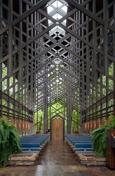 Glass walls flank pine trusses in Thorncrown Chapel in Eureka Springs Arkansas[OS][652x1000]