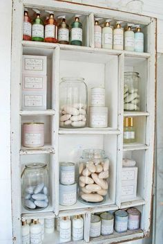 Using an old window frame - add shelving behind the frame. Use in the bathroom.