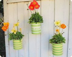 DIY hanging planters from plain metal paint cans. (something to with all those paint cans from the remodel) Paint Can Planters, Fence Planters, Diy Planters, Succulent Planters, Succulents Garden, Container Plants, Container Gardening, Plant Containers, Indoor Gardening