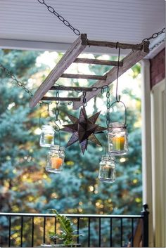 Outdoor patio ladder candle chandelier by Unskinny Boppy *Idea: Chain ladder to strong hooks in rafters. Wrap white lights around it. Wrap vined silk flowers around the light to hide wires. Hang plants from ladder rungs. Old Wooden Ladders, Wooden Ladder Decor, Rustic Ladder, Wooden Spools, Diy Pergola, Pergola Kits, Pergola Ideas, Patio Ideas, Diy Patio