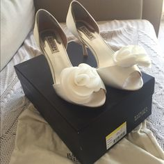 Badgley Mischka ivory satin peeptoe pump size 8 D'orsay 3 inch heel, ivory satin with flower detail on toe area, there is an ankle pad on the inside of the shoe near the back of the ankle that I am unable to remove (shown in second photo)  but it is necessary for comfort, these shoes were worn for approx 4 hours just for wedding pictures. Comes with original box and dustbag. Badgley Mischka Shoes Heels