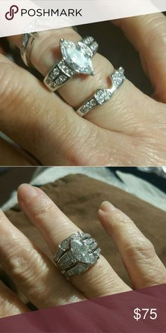 3 piece wedding ring, sterling silver. Center piece is a marquis shape with two matching bands that attach. Beatifully made. Jewelry Rings