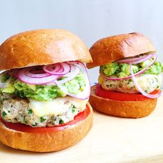 Spicy Chicken Burgers with Guacamole, Cheddar, and Pickled Onions