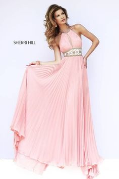 Spring 2015  # 11251 Elegant halter neckline ruches at the bust to create a tasteful keyhole and is trimmed with the same rich Mediterranean artwork as the fitted waistline on this classic pleated chiffon gown.