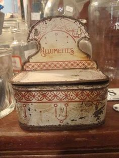 pretty old enamelware match container ( reminds me of my Grandma's kitchen!!)