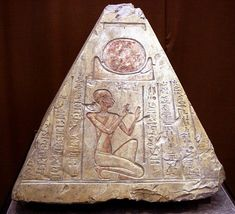 Pyramidion from the tomb of the priest Rer in Abydos, Egypt. A pyramidion (plural pyramidia) is the uppermost piece or capstone of an Egyptian pyramid or obelisk in archaeological parlance. They were called benbenet in the Ancient Egyptian language, which associated the pyramid as a whole with the sacred benben stone. During the New Kingdom, some private underground tombs were marked on the surface by small brick pyramids that terminated in pyramidia.