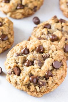 These thick, soft and chewy oatmeal chocolate chip cookies are made with brown sugar, old fashioned oats, chopped walnuts & lots of chocolate chips for the perfect bakery-style cookie.