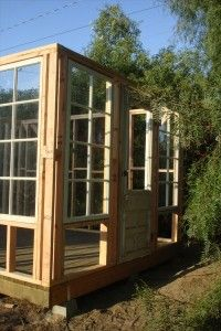 build a greenhouse using old windows   Old wood frame windows and an antique Victorian style door gives the ...