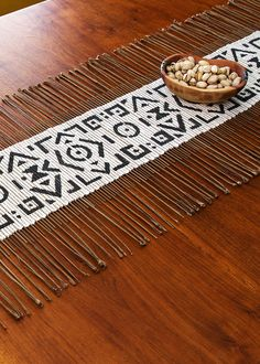 These African table runners are created by weaving dried twigs through through hand-dyed mud cloth fabric. #mudcloth