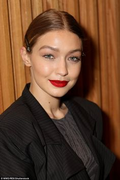 Good genes: Gigi pictured showing off her shimmery eye makeup, red lips and defined brows...