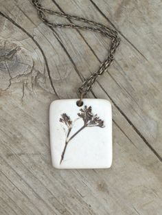 Earthy Porcelain Pendant with Queen Anne's Lace. $32.00, via Etsy.