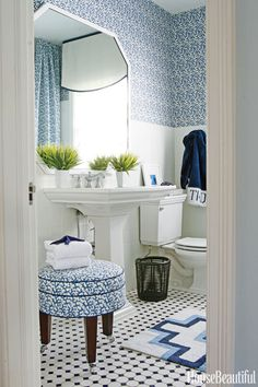 bathroom with blue and white coral-print fabric, vintage-style fixtures, classic black and white tile