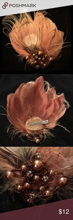 Peacock feather hair clip Beautiful steampunk inspired peacock feather hair clip. Worn once to a wedding. Subtle peachy color with beautiful bead work. One of a kind! Accessories Hair Accessories