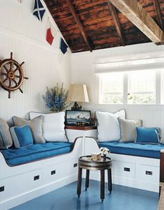 Cabin bed inspired sofas, bare wood and on trend accents create a sense of retro nautical elegance.