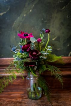 Pink, purple and blue bridesmaid bouquet with ranunculus, anemones, thistle and herbs by Grace & Thorn