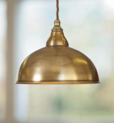 a pendant with a solid brass or steel shade made by jim lawrence brass pendant lighting