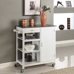 Add storage and counter space to your kitchen with this convenient and classy cart, in your choice of black or white. Three exterior shelves, a paper towel rack and more makes this the perfect way to free up your cooking area.