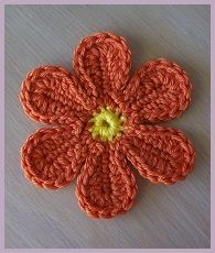 A couple of free crochet patterns; flower, easter egg, football coaster, awareness ribbon, baby booties and more