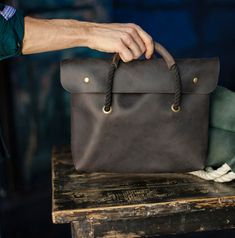 This is our new product. Good for inch. Made from crazy horse leather. Minimalistic black rope's handle with knots. Very comfortable handle. Have a pocket inside. Small Leather Bag, Wide Leather Belt, Satchel, Crossbody Bag, How To Make Rope, Black Rope, New Bag, Vintage Handbags, Natural Leather