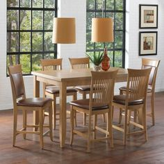 dining room with a high dining table and chairs of wood