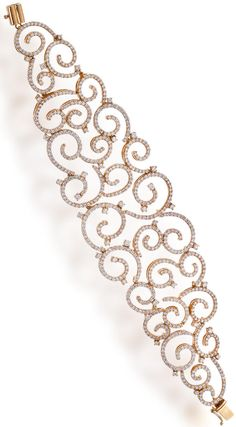 A diamond bracelet composed of gradated delicate scrolling links set with round brilliant-cut diamonds; estimated total diamond weight: 9.15 carats; mounted in eighteen karat rose gold; length: 6...