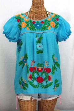 "Summer must-have!  The ""La Mariposa Corta de Color"" Embroidered Mexican Peasant Blouse in Aqua with Fiesta Embroidery. #bohemian"