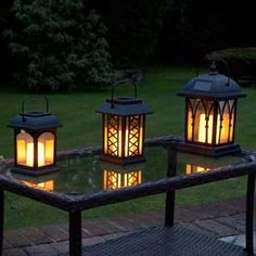 Festive Lights Garden Candle Lanterns - Solar Powered - Flickering Effect - Amber LED - 3 Pack Garden Candle Lanterns, Outdoor Candles, Outdoor Lantern, Solar Lantern Lights, Solar Hanging Lanterns, Candle Power, Garden Spaces, A Table, Patio Table