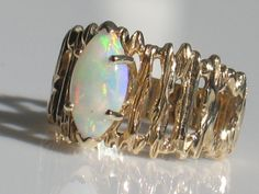 opal + gold...I had a ring VERY similar to this back in the 70's. Only difference I can see was mine had a slightly larger black opal.
