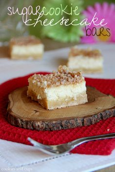 The cookies look great, but I love the piece of wood as a plate!  Sugar cookie cheesecake bars!