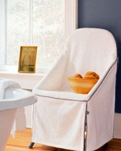 Terry Slipcover - An extra seat in the bathroom is always welcome, even though moist conditions may limit appropriate options. Try draping a wooden folding chair with a thick cotton-terry slipcover, and suddenly you have an inviting perch for a manicure, a blow-dry, or bathroom accessories.