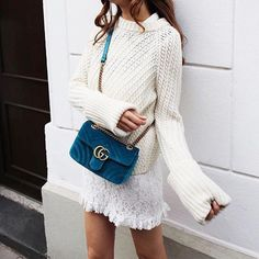Embrace winter whites by pairing a chunky knit sweater with a miniskirt