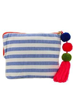 This clever little pouch sports classic stripes in contemporary hues. The fabric is 100% sweet, soft cotton woven by hand on pedal looms making the Coco both pliable and strong. Made in Mexico.
