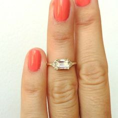 Another tiny custom engagement ring. This one has a .73 caret emerald cut white…