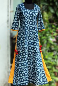 a long kurta in layers with handblock printed indigo fabric & pop coloured inner layer. the layered kurta has tie-ups and woolen fumdas to add to the pop! Salwar Designs, Blouse Designs, Pakistani Dresses, Indian Dresses, Indian Outfits, Kurta Patterns, Dress Patterns, Indian Attire, Indian Wear