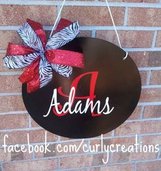14 Metal Family Name & Initial Door Hanger by shopcurlycreations  @Alicia Clark - this type of sign would hang between the blinds and the window on your door.