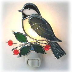 Light Up Any Room With This Beautiful Bird This expertly crafted stained glass chickadee will add whimsy and color to any decor. Handmade night light features real stained glass and bright nickel plating that will shine for years to come.  Measures 4 tall. Sold finished. Includes switch and bulb.