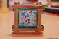 Popsickle stick picture frame (for kids to make and give their dads)...could also be a magnet on back and not a standing frame. Could also have their photo in it, and could write on the sticks