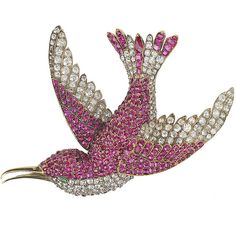 An antique jewelled humming bird brooch, naturalistically modelled mid flight with out swept wings, pavé set with cushion shaped rubies and old brilliant cut diamonds,the beak and feet in yellow gold, its eye mounted with a cabochon emerald.. English, circa 1890. Provenance: The collection of Marjorie Merriweather Post.