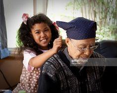 Grandfather and grandchild get massage from grandchild.#GettyImages.Prestage#MamiGibbs