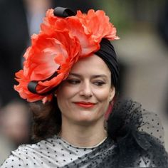 Miriam Gonzalez Durantez, the wife of Deputy Prime Minister Nick Clegg, channels a Forties vixen with this black turban embellished with coral flowers by milliner Conchitta.