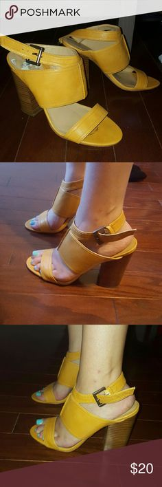 Nine West Mustard open toe stacked heel size 8 NINE WEST mustard colored open toe stacked heel in U.S. size 8.5, I am a true to size 8 and they fit fine. Thick straps go around the ankle. There are no flaws on the wooden stacked heel nor on the leather. Worn less than 3x times, heels are too high for me, but makes your legs look super long. Heel is 4 inches in height. Gold hardware on straps. Nine West Shoes Heels