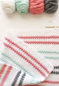 This is a free pattern for a crochet moss and puff stitch baby blanket. Hi there! Tiffany's daughter Hannah here. I recently made this crochet moss and puff stitch baby blanket for one of my husband's surgery co-residents who just had a baby girl and I love how it turned out.