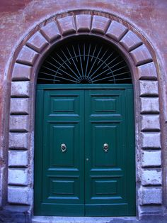 A rich shade of forest green on a door spotted in Italy