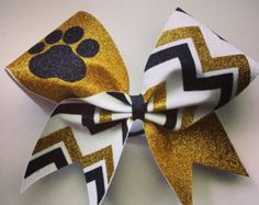Check out SALE White, gold and black glitter paw and chevron cheer bow. Ask about bulk discounts, color and mascot options. on bragabitbows