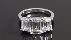 Emerald cut three stone ring .925 sterling silver AAAAA grade cubic zi