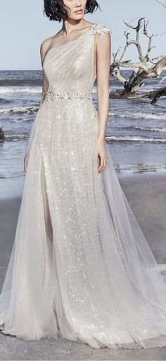 Sottero and Midgley - RONELLE, This unique wedding gown evokes Old Hollywood glamour, featuring glittering layers of ethereal tulle. A beaded motif featuring Swarovski Crystals at the one-shoulder neckline drifts into a gorgeous strap detail in the back. #Midgleybride #SotteroandMidgley #modernbride #syttd #chicweddings