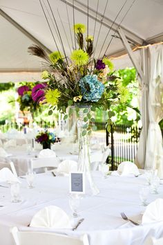 Peacock centerpieces - See more vow renewal ideas at IDoStill.com
